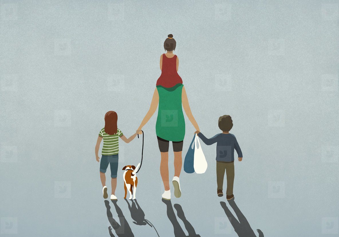 Family with dog holding hands and walking with grocery bags
