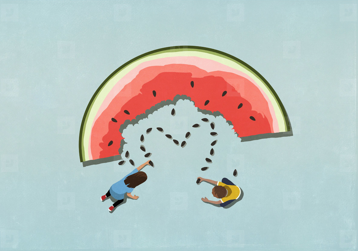 Boy and girl forming heart shape from watermelon seeds