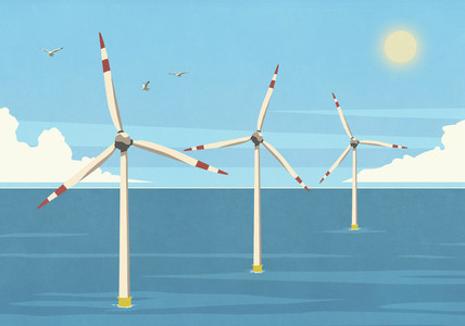 Wind turbines in sunny blue ocean