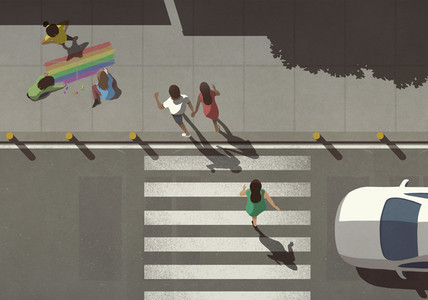 View from above pedestrians crossing street by kids coloring rainbow on sidewalk