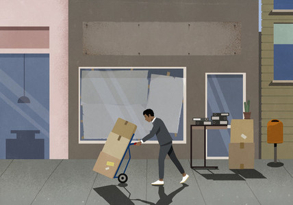 Businessman removing boxes from shutdown business storefront
