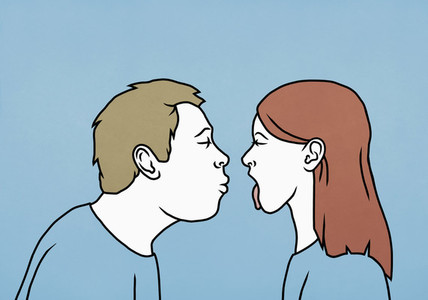 Contrasting couple sticking tongue out and kissing