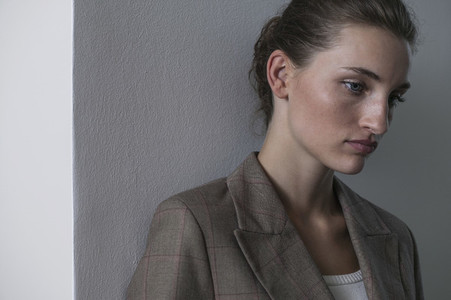 Portrait beautiful serene young businesswoman looking down