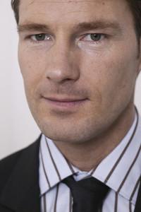 Close up portrait confident handsome businessman