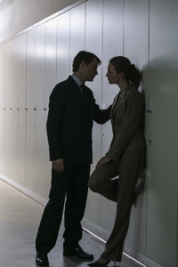Office romance business people at lockers