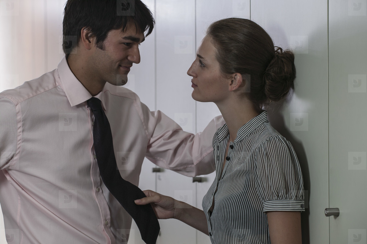 Businessman and businesswoman flirting