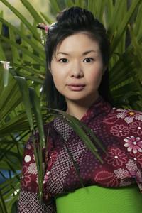 Portrait beautiful young woman in kimono among plants