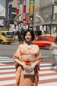 Portrait beautiful young woman in kimono on busy city street Izu Japan