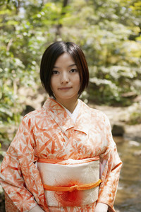 Portrait beautiful young woman in orange kimono