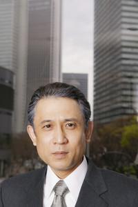 Portrait confident businessman in city