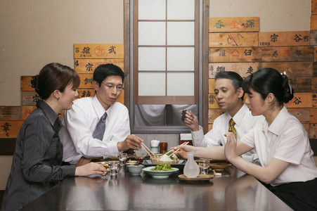 Japanese business people enjoying lunch in restaurant