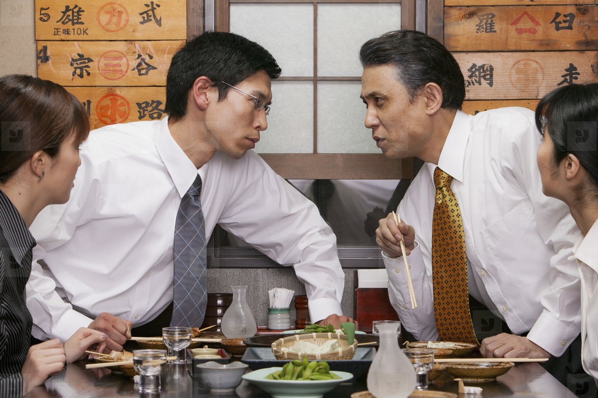 Business people talking and eating lunch in restaurant