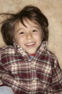 Portrait cute happy boy in plaid shirt