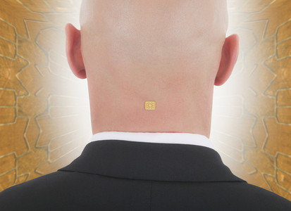 Close up businessman with computer chip in back of head