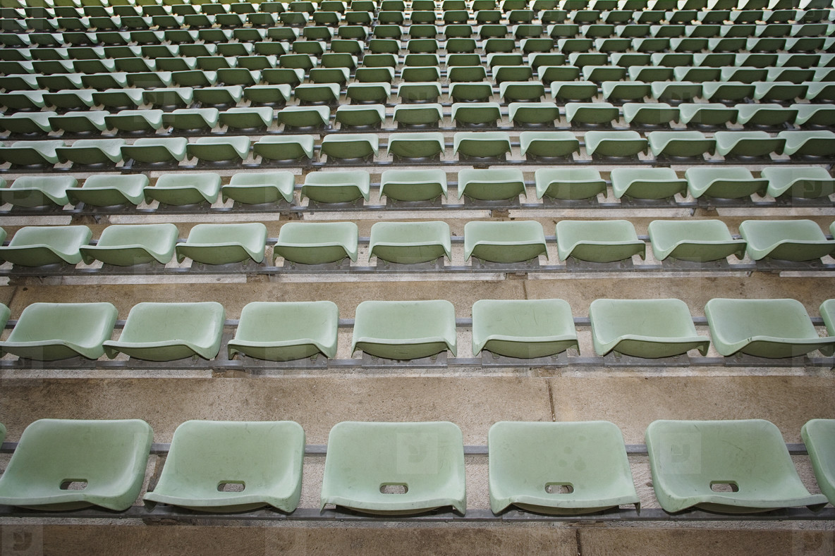 Rows of green seats in stadium