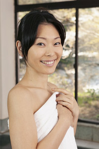 Portrait beautiful young woman in bathrobe at spa