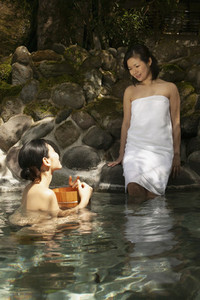 Young women friends relaxing at Onsen pool