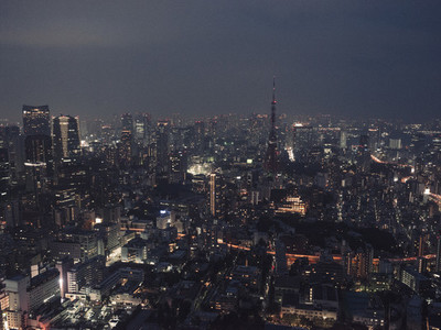 Illuminated highrise buildings and cityscape at night Tokyo Japan