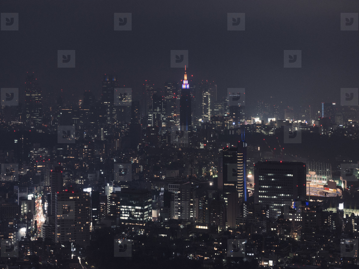 Illuminated cityscape buildings at night Tokyo Japan