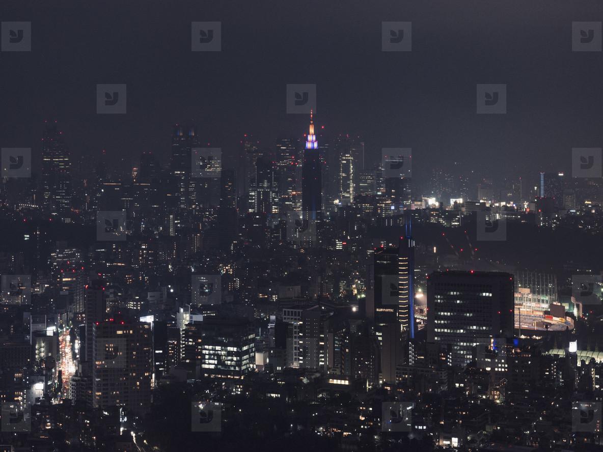 Illuminated cityscape buildings at night Tokyo Japan