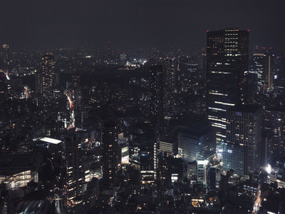 Illuminated buildings and cityscape at night Tokyo Japan