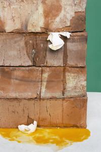 Bricks crushing eggs