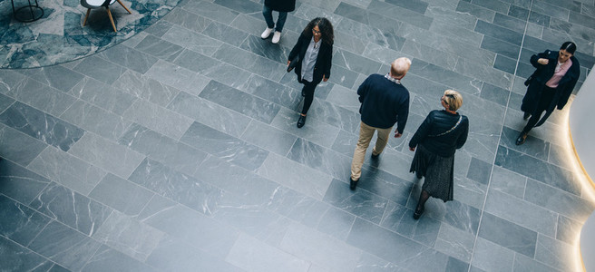People walking through a office hallway