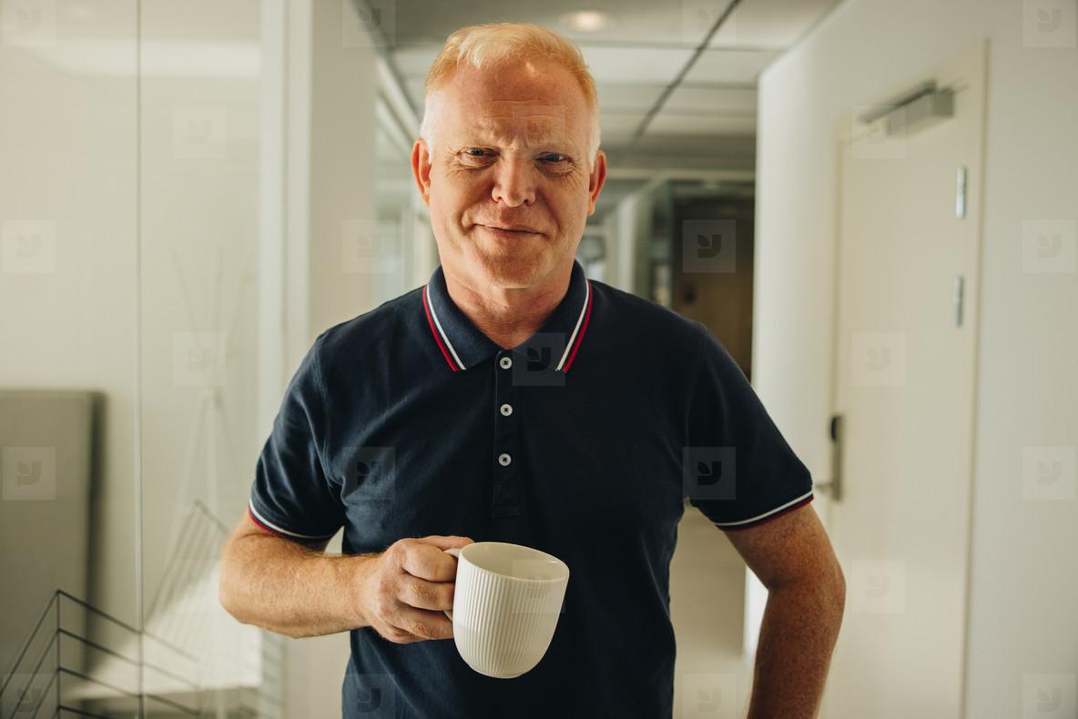 Entrepreneur having coffee break at work