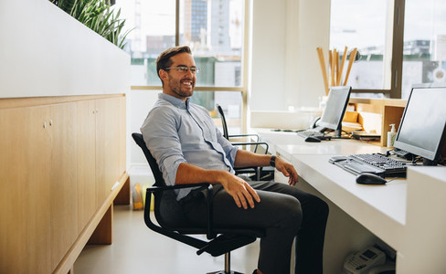 Successful businessman in office