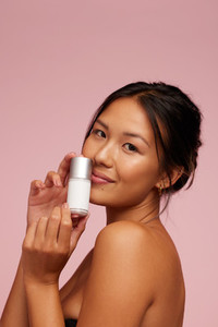 Woman with an effective beauty care product