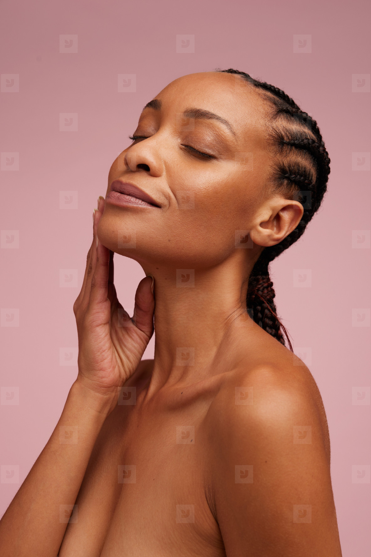 Woman touching her smooth and healthy facial skin