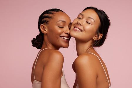 Two beautiful women with perfect skin
