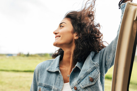Side view of brunette woman with her hair flying in the air