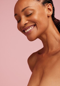 Smiling african woman with healthy skin