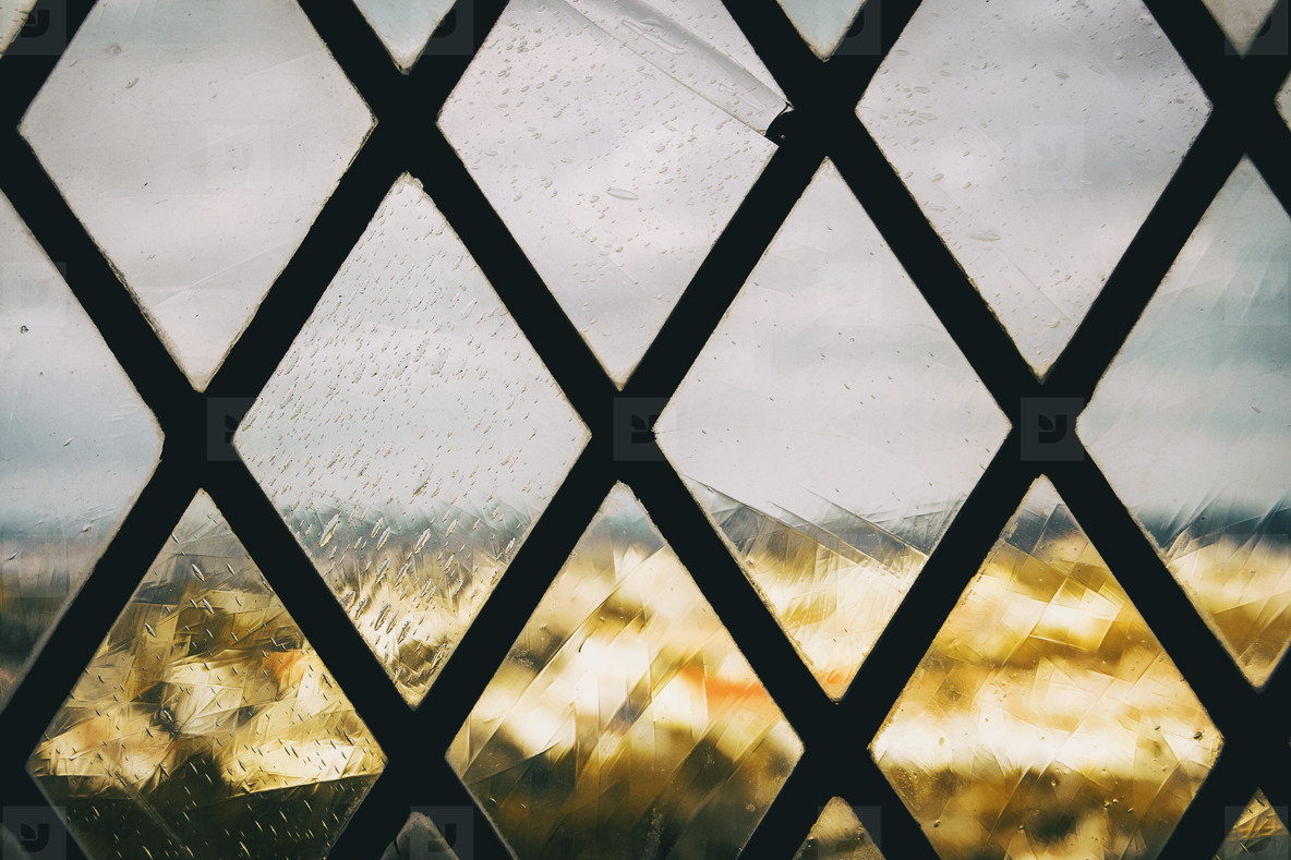 window with a grille with a wrought iron pattern