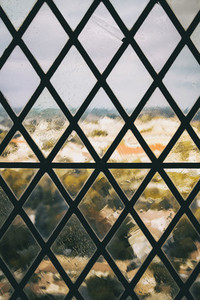 window with grille with a wrought iron pattern