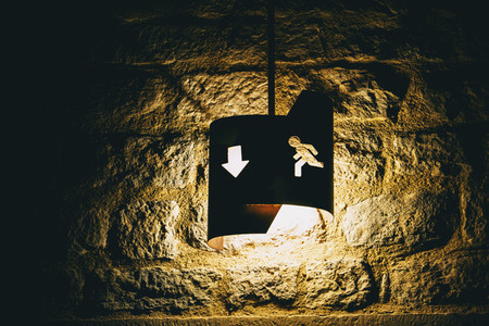 old fashioned emergency exit icon with backlit arrow
