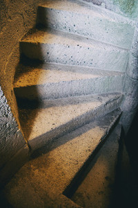 view of a spiral staircase made of old stone