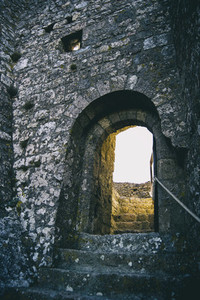 old stone stairs leading to a stone wall