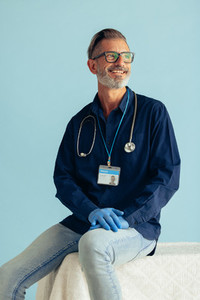 Medical professional smiling on blue background