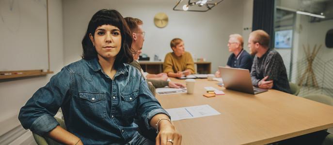 Woman sitting in meeting room