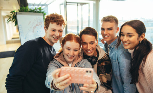 Young people taking selfie in college campus