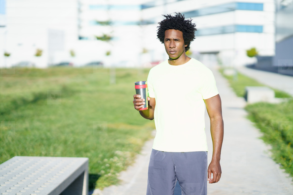 Black man drinking during exercise  Runner taking a hydration break