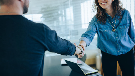 Two businesspeople handshake after meeting