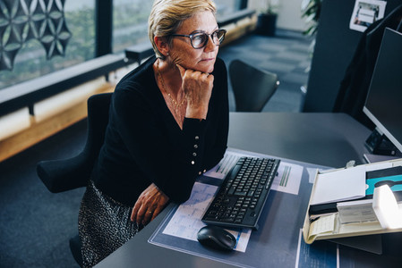 Senior businesswoman sitting at her desk