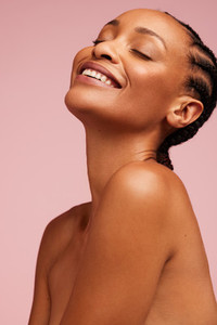 Smiling female model with healthy skin