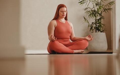 Yoga meditation in fitness studio