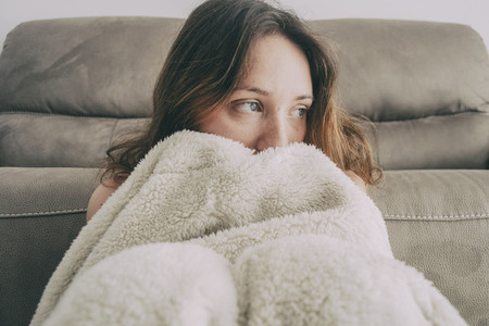girl covered with a blanket