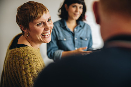 Businesswoman smiling during a meeting in office
