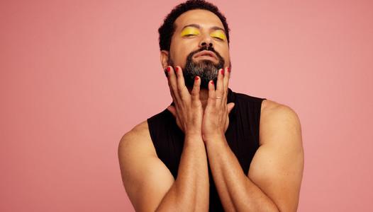 Gender fluid man with make up